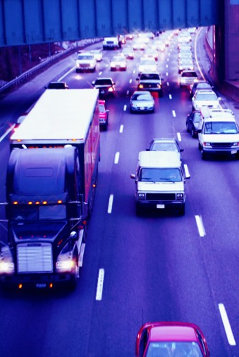 Commute traffic at rush hour, crowded highway : Stock Photo
