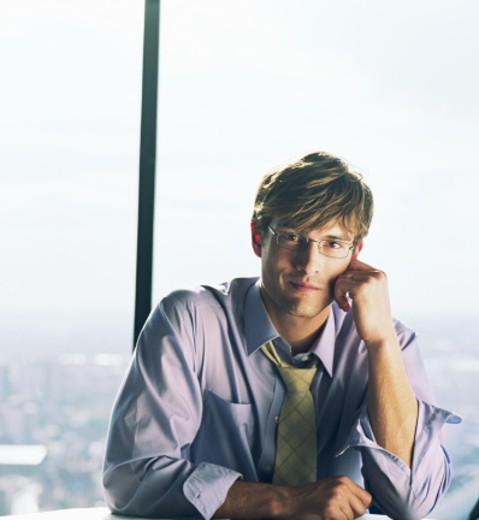 Stock Photo: 1598R-24658 Young businessman resting cheek on hand, portrait