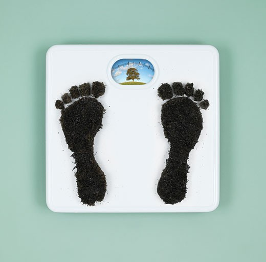 Coal footprints on weight scale, studio shot : Stock Photo