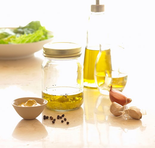 Still life with jar and bottle of olive oil : Stock Photo