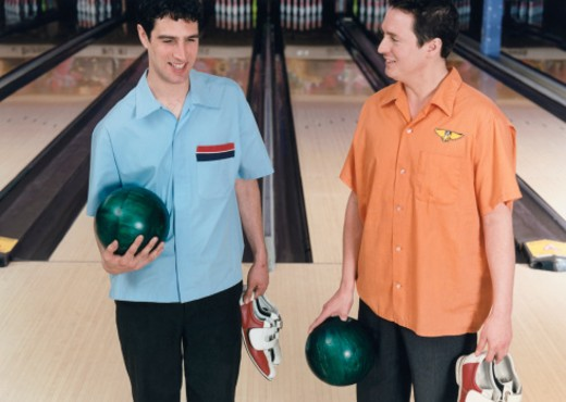 Two Men with Bowling Balls : Stock Photo