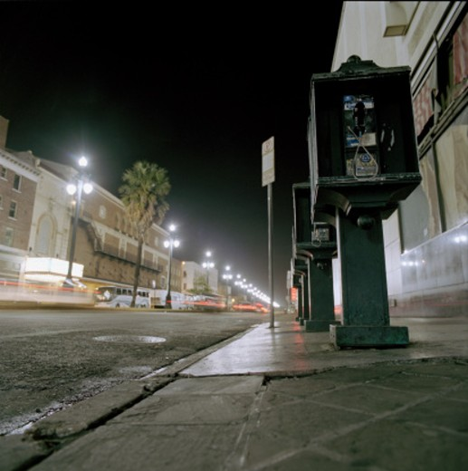 Telephones in Empty Street : Stock Photo