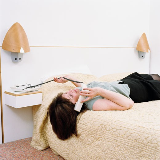 Woman Telephoning on Bed : Stock Photo