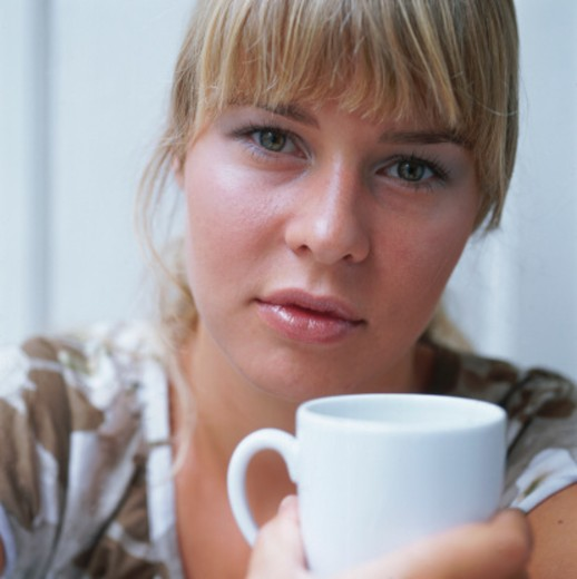 Stock Photo: 1598R-251038 Woman Holding Coffee Cup