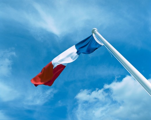 French flag blowing in wind, low angle view : Stock Photo