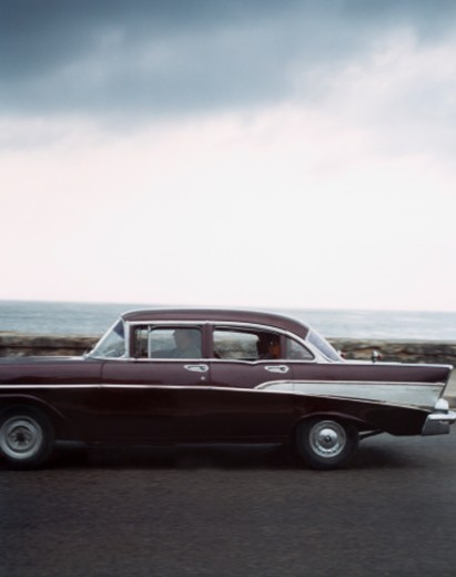 Stock Photo: 1598R-254859 Classic Car near Sea