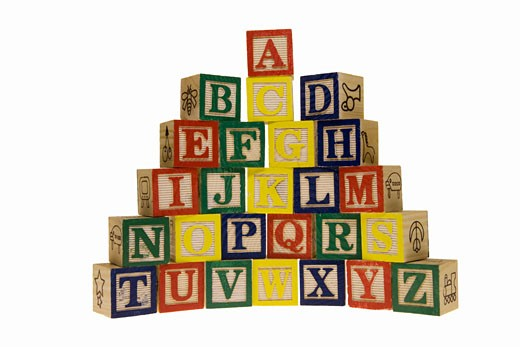 Stock Photo: 1598R-257670 Toy blocks arranged in alphabet