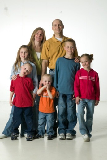 Two parents with five children, posing in studio, portrait : Stock Photo