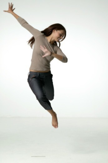 Stock Photo: 1598R-258753 Young woman in mid-air studio, portrait