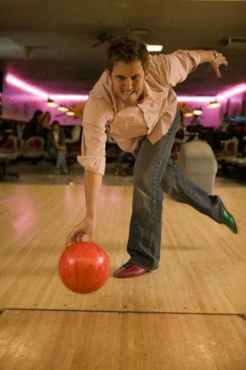 Man bowling ball down lane : Stock Photo
