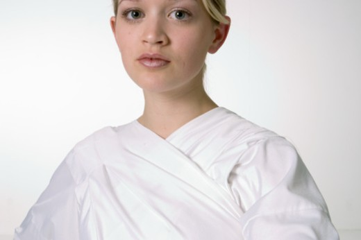 Young woman wearing white robe, posing in studio , portrait : Stock Photo