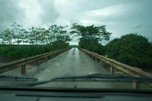 Car on bridge in countryside, view from inside : Stock Photo