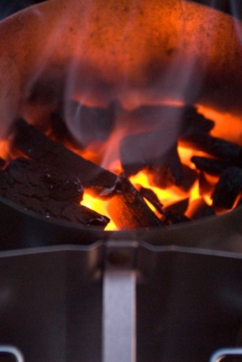 Stock Photo: 1598R-263845 Charcoal fire in chimney starter, close-up