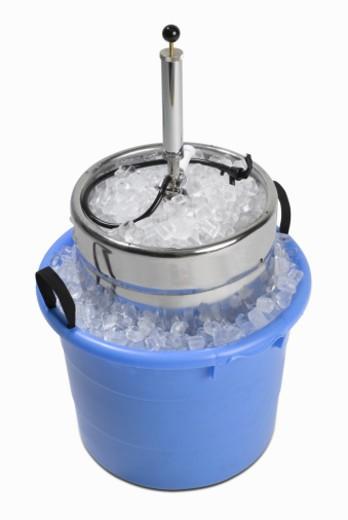 Beer keg in bucket of ice, elevated view : Stock Photo