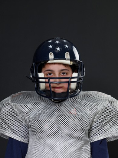Stock Photo: 1598R-265345 Boy (9-11) wearing football uniform, portrait