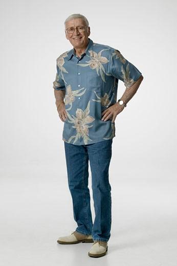Senior adult standing in studio, portrait : Stock Photo