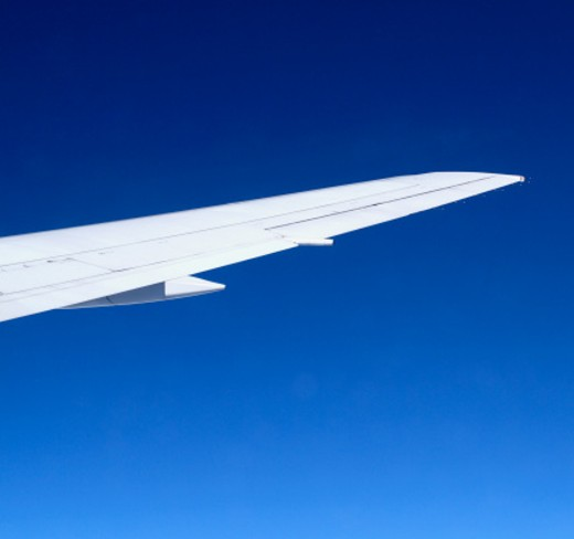 Wing of commercial airplane in mid-air : Stock Photo