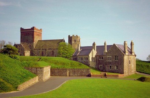 Road running through a grass area in front of the Dover Castle, Kent, England : Stock Photo
