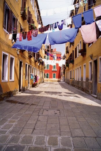 Clothes hanging over Ghetto street, Venice, Italy : Stock Photo