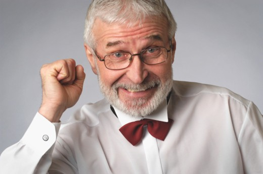 Stock Photo: 1598R-267862 Portrait of a senior man in a tuxedo holding up his fist