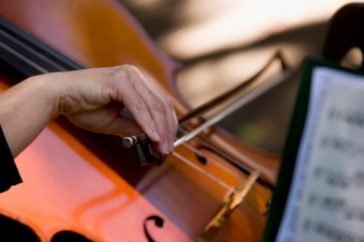 Stock Photo: 1598R-267975 Close-up of a woman playing the cello, Balboa Park, San Diego, California, USA