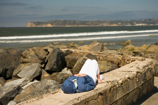Stock Photo: 1598R-268013 High angle view of a person lying on a wall, San Diego, California, USA