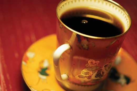 Stock Photo: 1598R-268608 Black coffee in ornate coffee cup