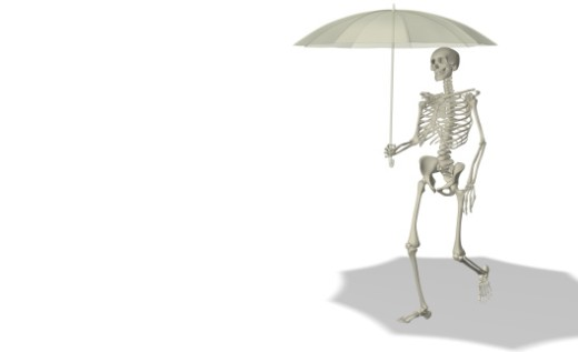 Close-up of a human skeleton holding an umbrella : Stock Photo