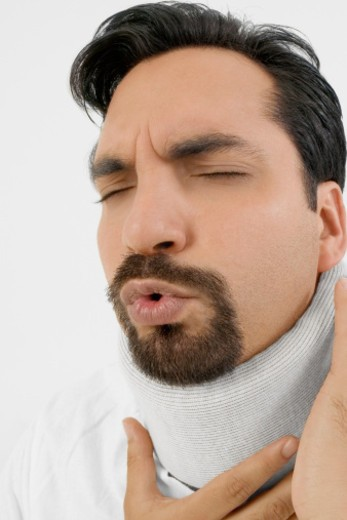 Stock Photo: 1598R-269668 Young man in neck brace