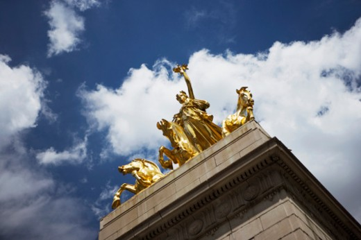 Stock Photo: 1598R-270043 Maine Monument at entrance to the Park at Merchants' Gate in New York City, NY, USA, low angle view