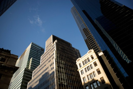 Stock Photo: 1598R-270134 Low angle view of skyscrapers, with a shorter building next to them in New York City, NY, USA