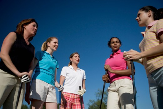 Stock Photo: 1598R-270937 Low angle view of five young women on a golf course