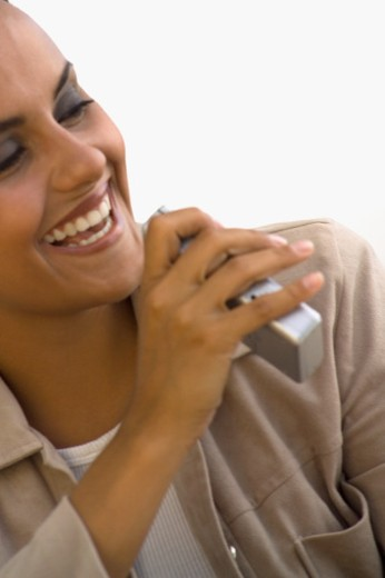 Close-up of a mid adult woman smiling : Stock Photo