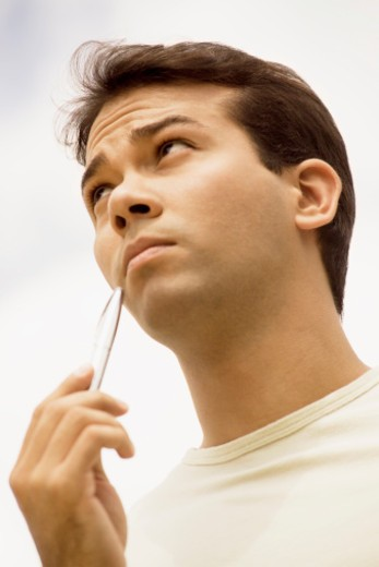 Close-up of a mid adult man looking away : Stock Photo