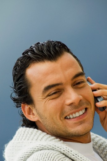 Stock Photo: 1598R-272785 Portrait of a mid adult man talking on a mobile phone