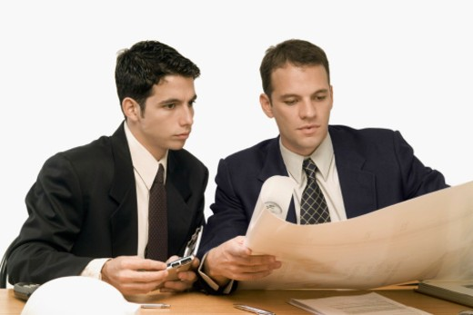 Two businessmen working in an office : Stock Photo