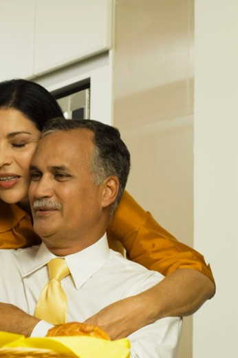 Stock Photo: 1598R-273217 Mature woman embracing a mature man