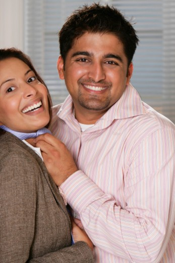 Close-up of a heterosexual couple smiling : Stock Photo