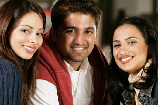 Portrait of two young women and a young man : Stock Photo