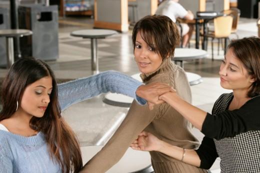 Stock Photo: 1598R-274869 Three young women talking
