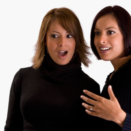 Stock Photo: 1598R-274969 Close-up of two young women looking surprised