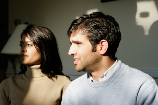 Stock Photo: 1598R-275809 Close-up of a young couple looking away