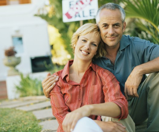 Couple outdoors, mature man embracing woman, smiling, portrait : Stock Photo