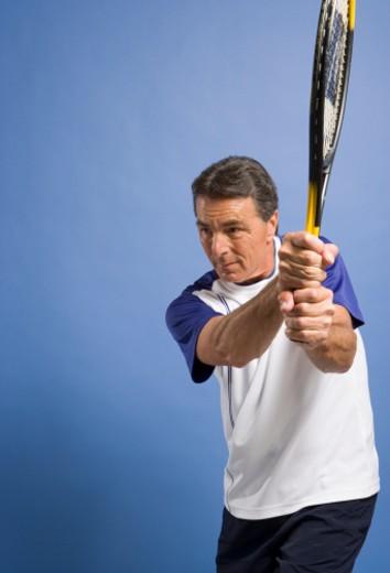 Senior man playing tennis : Stock Photo