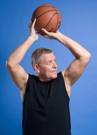 Mature man playing basket ball : Stock Photo