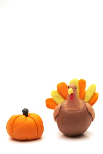 Clay model of Thanksgiving turkey and pumpkin on a white background : Stock Photo