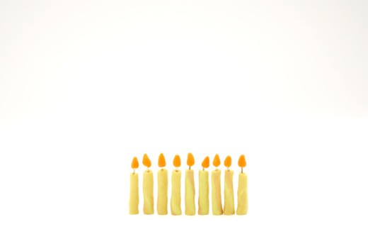 Chanuklyah candles made of clay on a white background : Stock Photo