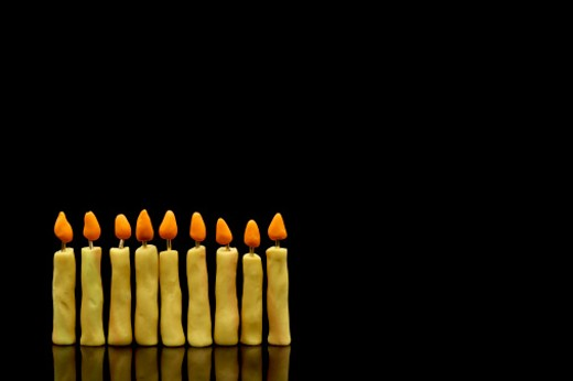 Chanuklyah candles made of clay on a black background : Stock Photo