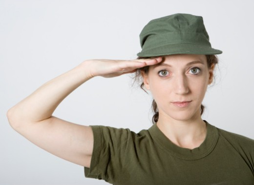 Female soldier saluting, close-up, portrait : Stock Photo