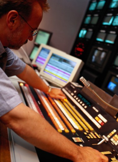 Man over Television Camera Control Panel : Stock Photo